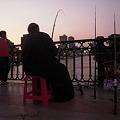 Photos: 夕暮れのナイル川で釣りをする人